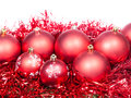 Many red christmas baubles and tinsel isolated on white background Royalty Free Stock Image