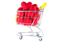 Many red hearts in shopping cart side view Stock Photos