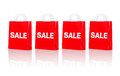 Many red shopping bags with sale word Royalty Free Stock Photo