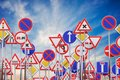 Many road signs against blue sky. 3D rendered illustration