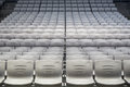 Many rows of plastic seats at a grandstand empty viewed from the front Royalty Free Stock Photos
