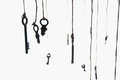 Many rustic keys hanging on string. Selective focus. Isolated Royalty Free Stock Photo