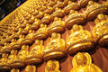 Many small buddha statue on the wall at chinese temple thailand Royalty Free Stock Images
