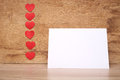 Many small hearts and a blank sheet of paper to record Royalty Free Stock Photography