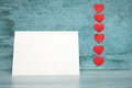 Many small hearts and a blank sheet of paper to record Royalty Free Stock Image