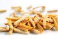 Many small salty dried rusks on white isolated background Stock Photo