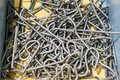 Many small wire or steel rod after frizzle product form automatic wire bending machine in bucket Royalty Free Stock Photo