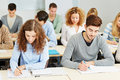 Many students lecture university classroom taking notes Royalty Free Stock Photo