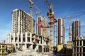 Many tall buildings under construction and cranes Royalty Free Stock Photo