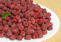 Many tasty fresh raspberries closeup Stock Photos