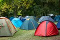 Many tents in nature at a festival campsite Stock Images