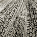 Many Tire Tracks in Sand. Royalty Free Stock Photo