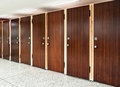 Many toilet doors eight rosewood at public restroom Royalty Free Stock Photos