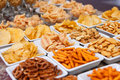 Many types of savoury snacks in white dishes Stock Image