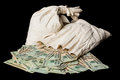 Many US dollar bills or notes with money bags Royalty Free Stock Photo