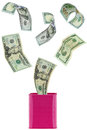Many USD dollar banknote money flying in to or out of pink metal Royalty Free Stock Photo