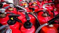 Many used fire extinguishers, top view Royalty Free Stock Photo