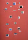 Many various windows on wall Royalty Free Stock Photo