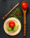 Many vegetables cucumber lemon pepper and tomato on wooden spoon wooden plate Stock Photo