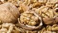 Many walnuts shelled and in-shell macro Royalty Free Stock Photo