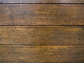 Many water drops on wooden surface Royalty Free Stock Photo