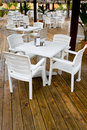 Many white plastic chairs and tables Stock Photo