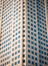 Many windows from the high rise building shot in symmetric composition from a public road Stock Images