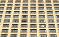Many windows on residential building hotel in city Stock Photos