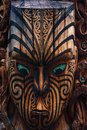 Maori totem detail of a warrior carved in a pole Stock Photography