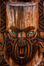 Maori totem detail of a warrior carved in a pole Stock Image