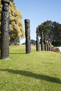 Maori totem poles or pou eight carved making the th anniversary of the battle of gate pa on april in tauranga new zealand Stock Photo