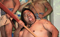 Maori warrior with tongue sticking out on haka dance new zealand Royalty Free Stock Photos