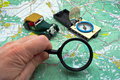 Map, compass and magnifying glass Royalty Free Stock Photos