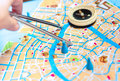 Map and compass selecting a route on a Stock Photography