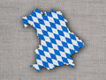 Map and flag of Bavaria on old linen