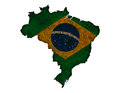 Map and flag of Brazil on rusty metal