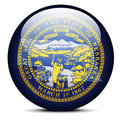 Map on flag button of USA Nebraska State Royalty Free Stock Photo
