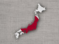 Map and flag of Japan on old linen Royalty Free Stock Photo