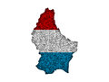 Map and flag of Luxembourg on poppy seeds