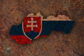 Map and flag of Slovakia on rusty metal