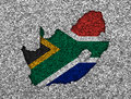 Map and flag of South Africa on poppy seeds