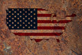 Map and flag of the USA on rusty metal Royalty Free Stock Photo