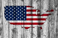 Map and flag of the USA on weathered wood Royalty Free Stock Photo