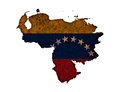Map and flag of Venezuela on rusty metal