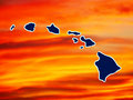 Map of hawaiian islands a with a colorful sunset in the background Royalty Free Stock Photography