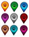 Map pointer with dog paw print collection inside Royalty Free Stock Images