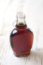 Maple syrup a full bottle of real Royalty Free Stock Photos