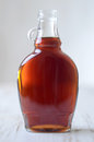 Maple syrup a full bottle of real Stock Images