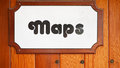 Maps sign posted on a wood wall Stock Photography
