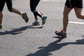 Marathon runners feet in motion Royalty Free Stock Photography